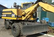 Koparka kołowa Caterpillar M312 15 ton 1998
